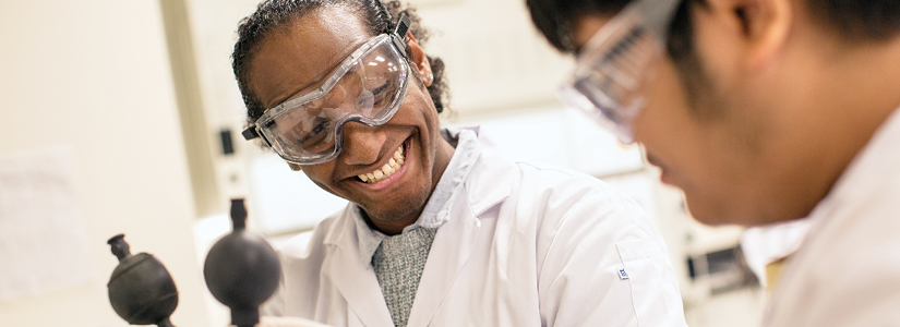 photo of two students working together in a lab.